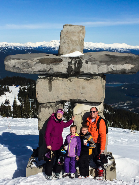 Whistler with kids Inukshuk - symbol of the 2010 Olympic Winter Games