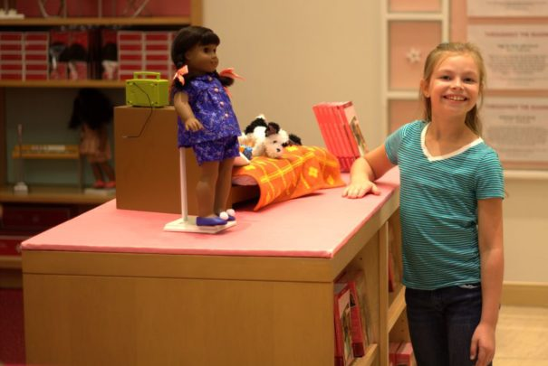 Cadence posing with the dolls at American Girl Place.