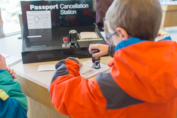 Stamping the kids' passports in the Rocky Mountain National Park Visitor Center