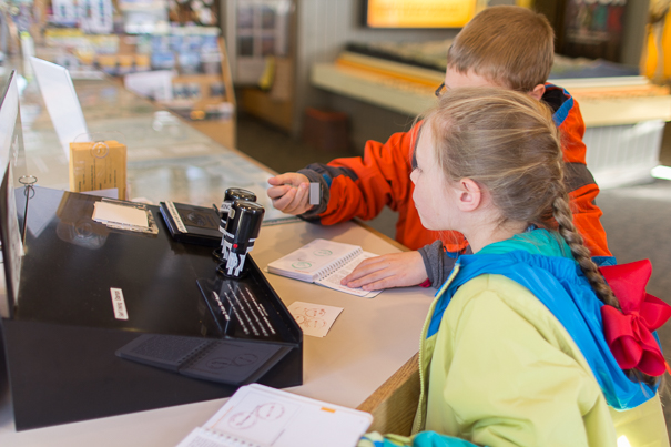 Visitor Center Passport Stamps in Rocky Mountain National Park with kids