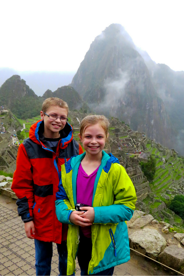 What could be better than exploring the Incan citadel of Machu Picchu with Kids? Maybe alpaca hugs, but I digress. It's a fabulous family destination, but can be a little tricky to get to! Here's our guide on how we did it. #familytravel #machupicchu #Peru