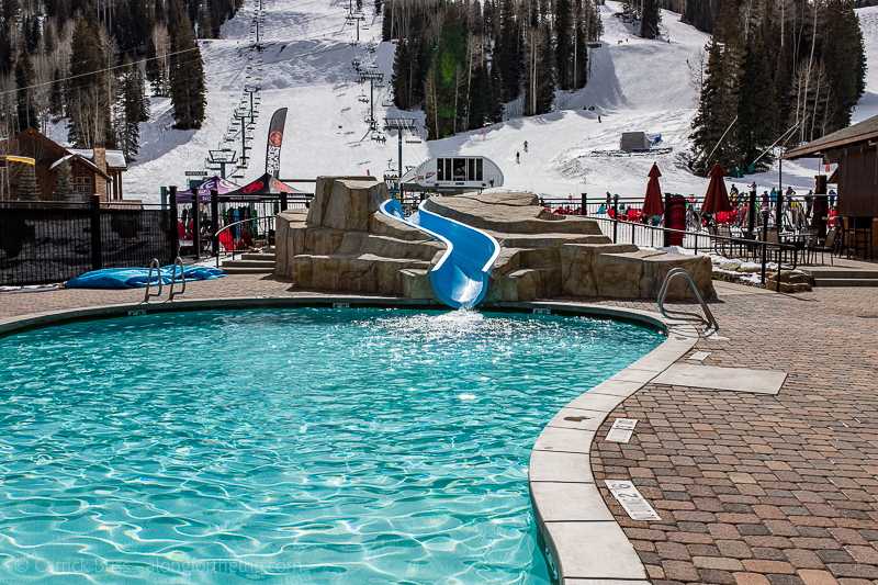 Top family ski resorts - outdoor heated pool and waterslide at the Purgatory Resort Hotel