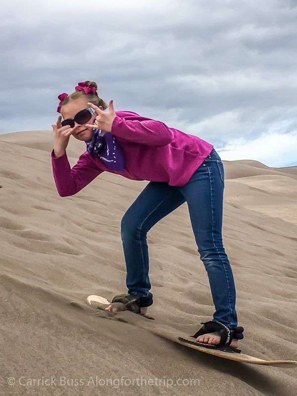 Sand surfing at Great Sand Dunes National Park