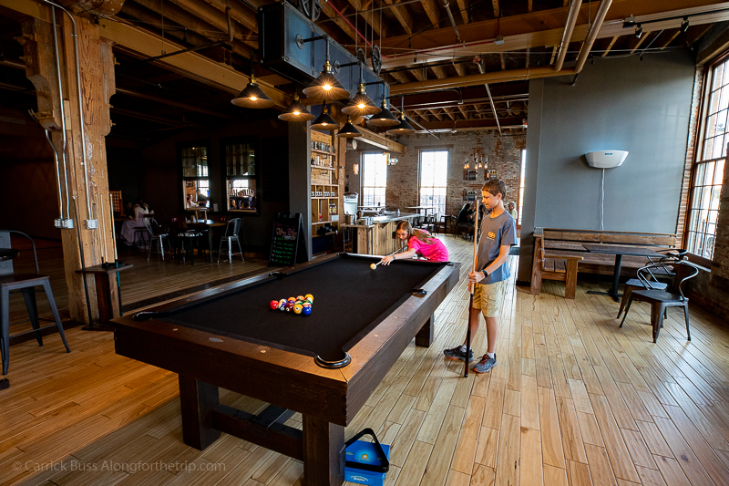 Shooting pool at Backpocket Taproom - Novelty Iron Works